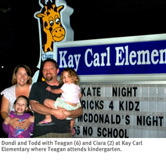 Photo of WriteSteps Common Core staffers Dondi and Todd Daugherty with daughters Teagan and Ciara at Teagan's school.