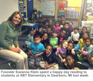 Photo of Suzanne Klein with students at ABT Elementary School.